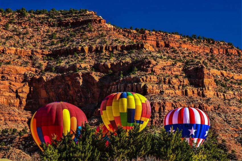Hot Air Balloons rise above the desert landscape in Kanab, UT